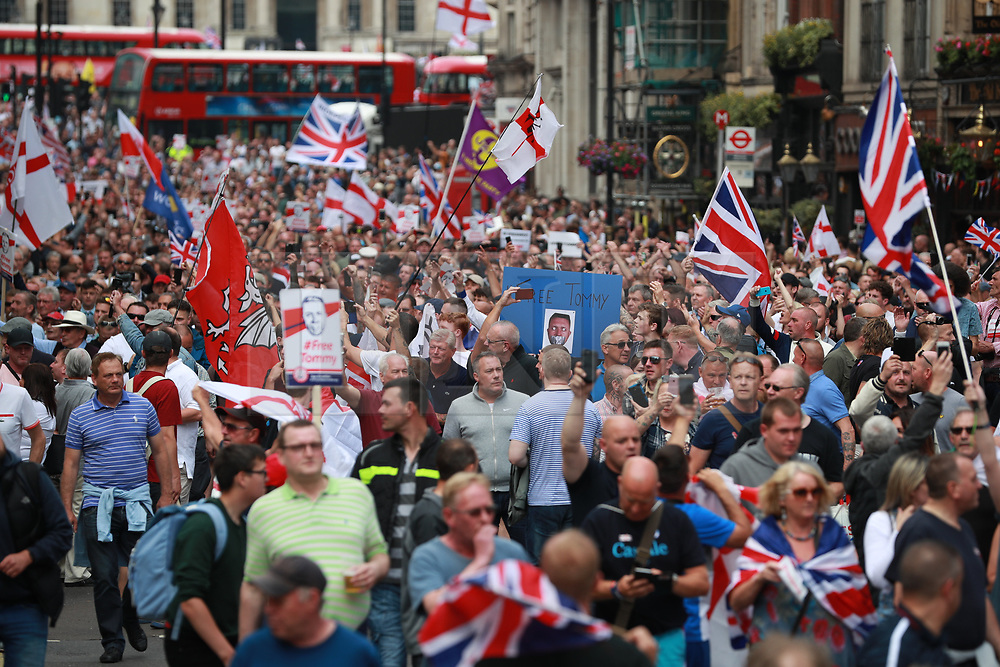 © Licensed to London News Pictures. 09/06/2018. London, UK. Thousands of supporters of EDL founder Tommy Robinson ( real name Stephen Yaxley-Lennon ) demonstrate in Westminster after Robinson was convicted of Contempt of Court . Robinson was already serving a suspended sentence for Contempt of Court over a similar incident , when he was convicted on Friday 25th May 2018 . Photo credit: Joel Goodman/LNP