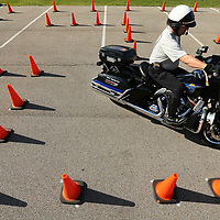 Tupelo Police Corporal Philip Sanderson drives through a maze of cones as he trains with other officers at the Parking lot at Veterans Park behind Tupelo Fire Station 3. The five motor officers get together for training every month, sometimes twice, to hone their skills that help them in traffic or on their way to a call.