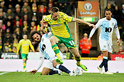 Norwich City midfielder Marco Stiepermann (18)  skips past Blackburn Rovers midfielder Bradley Dack (23)  during the EFL Sky Bet Championship match between Norwich City and Blackburn Rovers at Carrow Road, Norwich, England on 27 April 2019.