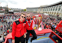 Bristol City's Aden Flint and Bristol City's Wade Elliott hold the Sky Bet League one Trophy on the bus,  in front of thousands of fans gathered at the amphitheatre in Bristol  - Photo mandatory by-line: Joe Meredith/JMP - Mobile: 07966 386802 - 04/05/2015 - SPORT - Football - Bristol -  - Bristol City Celebration Tour