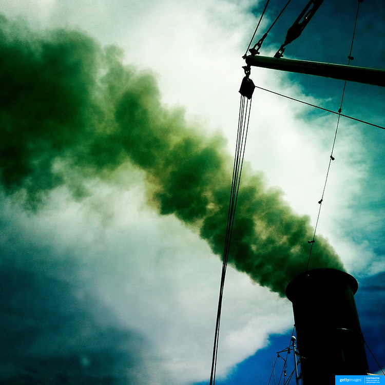 Smoke billows from the chimney on the TSS Earnslaw, the 100 year old vintage coal fired passenger steam ship which sails on Lake Wakatipu, Queenstown, New Zealand. The popular tourist attraction is celebrating it's centenary year with celebrations planned for October 2012.  Queenstown, Central Otago, New Zealand. 29th February 2012. Photo Tim Clayton