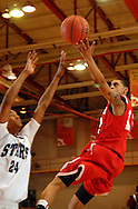5 MARCH 2011 -- NORMANDY, Mo -- Chaminade College Prep basketball player Tevin Evans (12) puts up a shot over McCluer North High School's Galen Brown (24) during the MSHSAA Class 5 boys basketball quarterfinals at Mark Twain Hall on the University of Missouri - St. Louis campus in Normandy, Mo. Saturday, March 5, 2011. The Stars upset the Red Devils 57-56 to advance to MSHSAA semifinals. Image © copyright 2011 Sid Hastings.