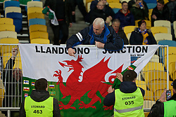 KIEV, UKRAINE - Easter Monday, March 28, 2016: A Wales supporter put up his flag before the International Friendly match against Ukraine at the NSK Olimpiyskyi Stadium. (Pic by David Rawcliffe/Propaganda)