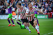 Sheffield Utd forward Billy Sharp (10) celebrates the first goal 1-0 during the EFL Sky Bet Championship match between Sheffield United and Bristol City at Bramall Lane, Sheffield, England on 30 March 2019.