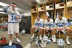 19 April 2008: North Carolina men's lacrosse attackman Gavin Petracca (14), defenseman Michael Jarvis (8), attackman Kevin Federico (3) and midfielder Sean Burke (42) during halftime while playing the Hofstra Pride at Kenan Stadium in Chapel Hill, NC.