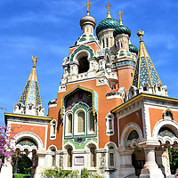 Russian Orthodox St. Nicolas Cathedral in Nice, France <br /> Colorful stones, bricks and ceramics were used to finish the striking façade of the Russian Orthodox St. Nicolas Cathedral in Nice, France.  On top of the green tiled onion domes are gilded crosses. Also notice the ornate windows that are decorated with a tin-glazed pottery called majolica plus a huge mosaic of the Holy Face of Christ.  In the sunlight, the La Cathedrale Orthodoxe Russe Saint-Nicolas becomes a sparkling gem.