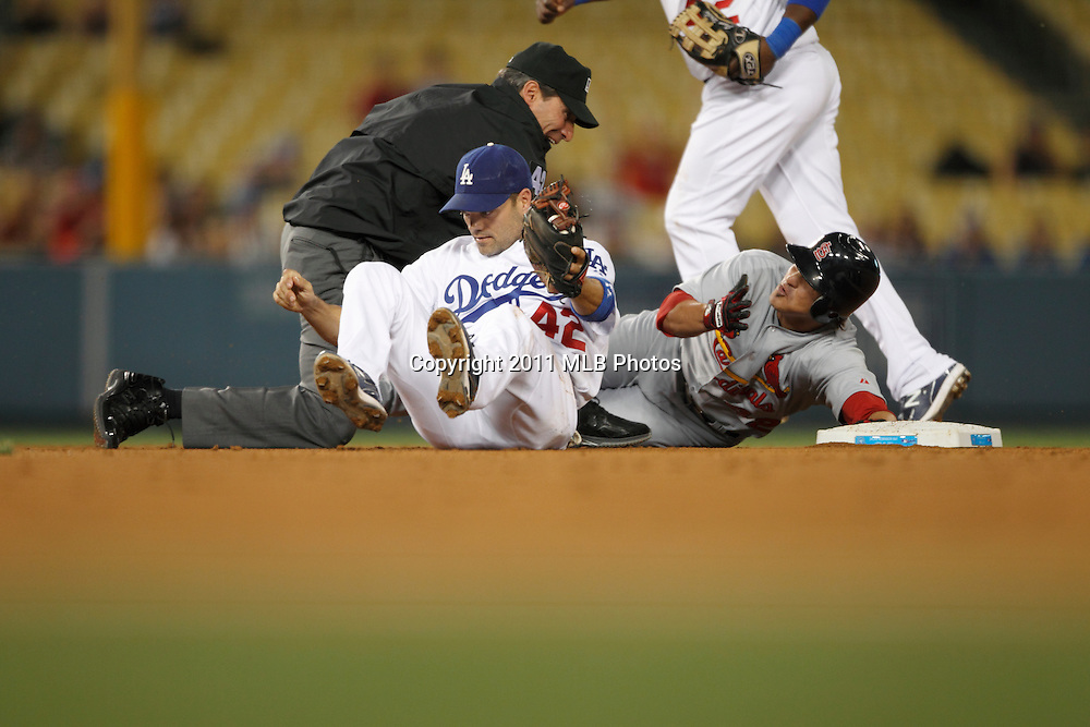 LOS ANGELES, CA - APRIL 15:  Ryan Theriot #3 of the St. Louis Cardinals argues a call at second base when he was called out by second base umpire Angel Hernandez during the game between the St. Louis Cardinals and the Los Angeles Dodgers on Friday April 15, 2011 at Dodger Stadium in Los Angeles, California. (Photo by Paul Spinelli/MLB Photos via Getty Images) *** Local Caption *** Ryan Theriot;Angel Hernandez