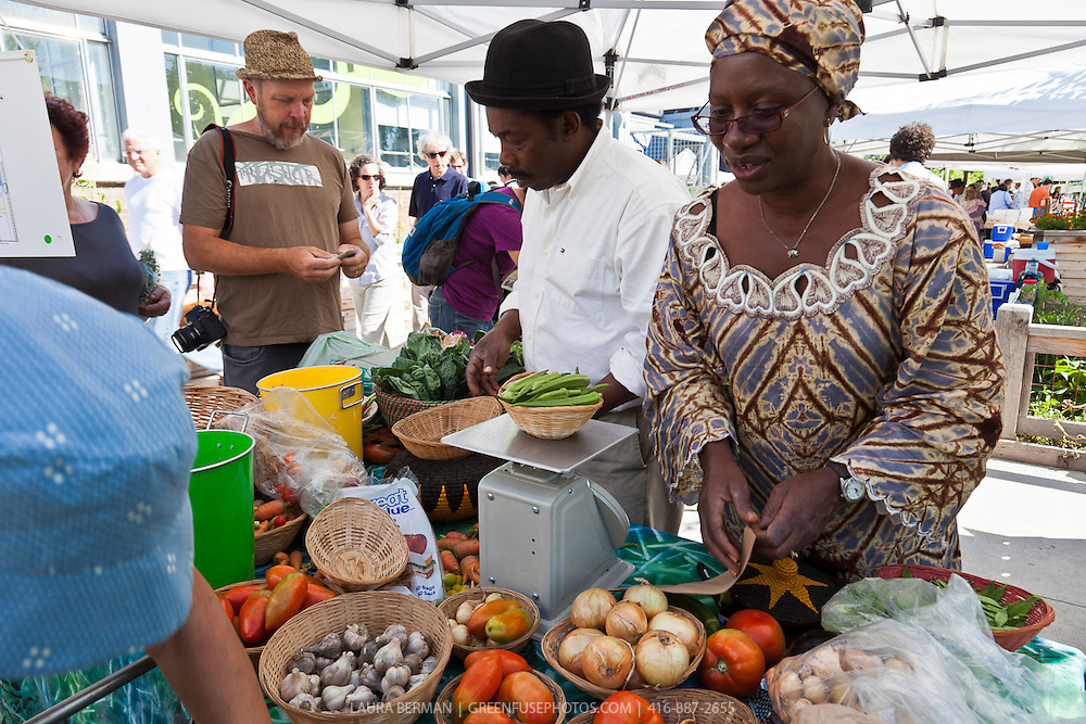 Southern Horizons farmers Margaret Zondo and Rodney Garnes selling their locally grown, organic vegetables at Wychwood farmers market.