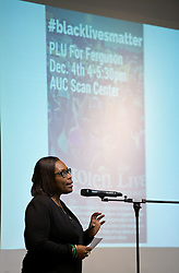 Angie Hambrick opens the forum discussion of issues surrounding deaths of African-Americans by police and is sponsored by the Diversity Center, Women's Center and CCES held in the Scandinavian Center at PLU on Thursday, Dec. 4, 2014. (PLU Photo/John Froschauer)