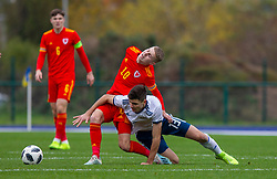 CARDIFF, WALES - Saturday, November 16, 2019: Wales' Keenan Pattern and Russia's Kirill Kravtsov during the UEFA Under-19 Championship Qualifying Group 5 match between Russia and Wales at the Cardiff International Sports Stadium. (Pic by Mark Hawkins/Propaganda)