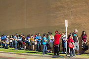 "25 AUGUST 2012 - PHOENIX, AZ:  People wait in the parking lot for the deferred action workshop to open its doors Saturday morning. The line snaked through the parking lot. Hundreds of people lined up at Central High School in Phoenix to complete their paperwork to apply for ""Deferred Action"" status under the Deferred Action for Childhood Arrivals (DACA) program announced by President Obama in June. Volunteers and lawyers specialized in immigration law helped the immigrants complete the required paperwork. Under the program, the children of undocumented immigrants brought to the US before they turned 16 years old would not be subject to deportation if they meet a predetermined set of conditions.    PHOTO BY JACK KURTZ"