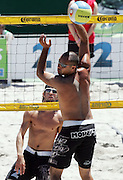 Craig Seuseu (NZ) watches the ball go past from Brad Tuttun (AUS) at the NZ Beach Volleyball Open at Stanley St, Auckland, New Zealand on Friday 20 January, 2006. Photo: Hannah Johnston/PHOTOSPORT<br />