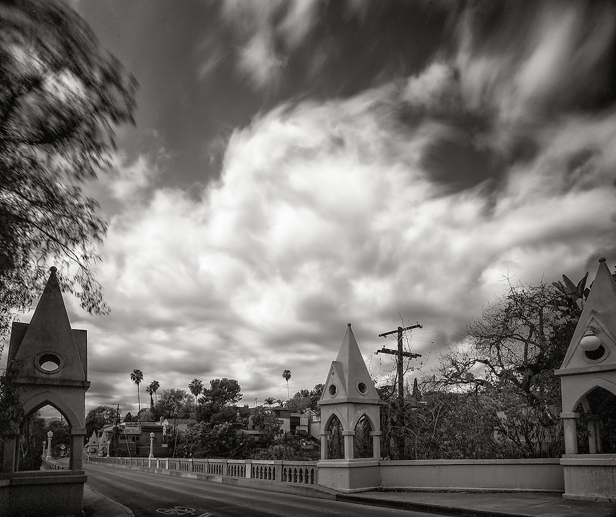 A long exposure captures the movement of clouds above Shakespeare Bridge in Los Feliz. The clouds are part of the first of two systems bringing rain to the Los Angeles area in February of 2014. The rain is welcome in California, which is experiencing a devastating drought, but also may also bring mudslides and flooding, specially to areas beneath burned hillsides.