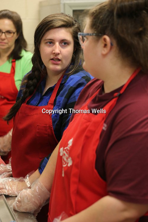 Lindsey Fulmer, left, chats with her sister, Lee Ellen, as they help serve breakfast at All Saints in Tupelo.