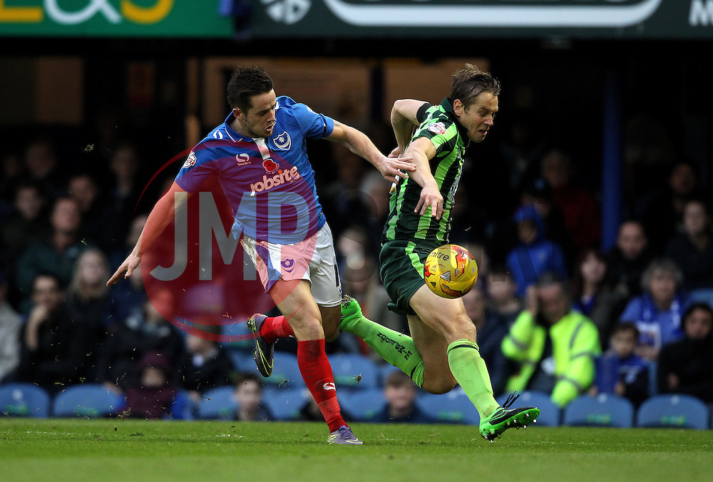 Dannie Bulman of AFC Wimbledon and Marc McNulty of Portsmouth battle for possession - Mandatory byline: Robbie Stephenson/JMP - 07966 386802 - 15/11/2015 - Rugby - Fratton Park - Portsmouth, England - Portsmouth v AFC Wimbledon - Sky Bet League Two