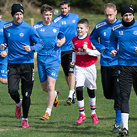 St Johnstone Training....11.04.14<br /> Steven MacLean during training this morning ahead of Sunday's Scottish Cup semi-fnal against Aberdeen pictured running with his son Luke who joined in training<br /> Picture by Graeme Hart.<br /> Copyright Perthshire Picture Agency<br /> Tel: 01738 623350  Mobile: 07990 594431