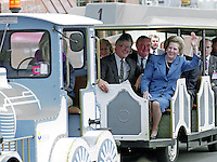 A wave from Prime Minister Margaret Thatcher as she travels by fairground type  train from the Bournemouth Conference Centre to her hotel during the Conservative Party's annual conference in October 1990. This was to be the last party conference she attended as prime minister. Sitting beside her is Kenneth Baker, MP, Chancellor of the Duchy of Lancaster. Immediately behind and between them is Peter Morrison, Mrs Thatcher's Parliamentary Private Secretary. 19901049MT5<br />