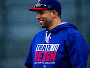 Texas Rangers first baseman James Loney (18) smiles as rain falls during a spring training workout at the team's training facility on Saturday, February 18, 2017 in Surprise, Arizona. (Ashley Landis/The Dallas Morning News)