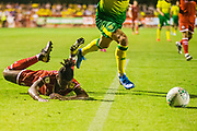 David Sesay (Crawley Town) falls onto the pitch on his way to the goal mouth during the EFL Cup match between Crawley Town and Norwich City at The People's Pension Stadium, Crawley, England on 27 August 2019.