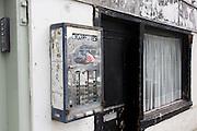 Old cigarette dispenser in a high street, Deal Kent.