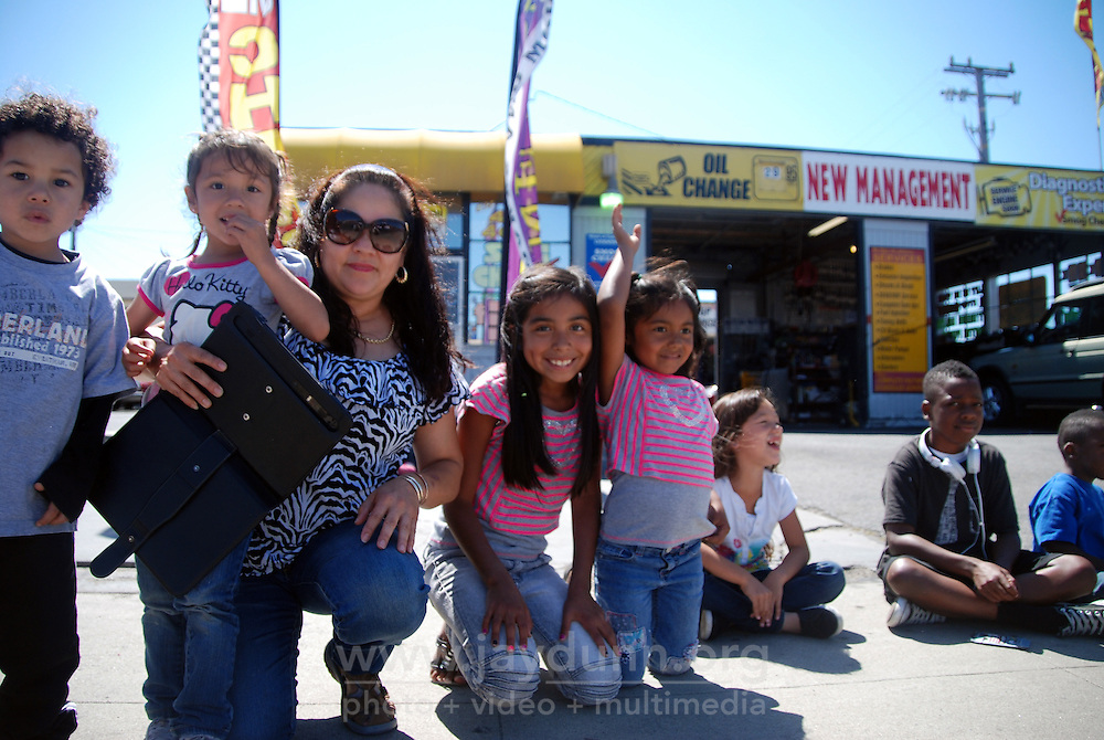 Clara Jimenez and her day care children enjoy the North Main Street mini-parade courtesy of the 102nd California Rodeo Salinas, which opened Thursday night, July 19 for a four-day run.