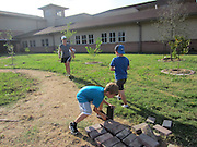 Briargrove Elementary School students, parents and staff participate in the Green Apple Day of Service to beautify their campus.