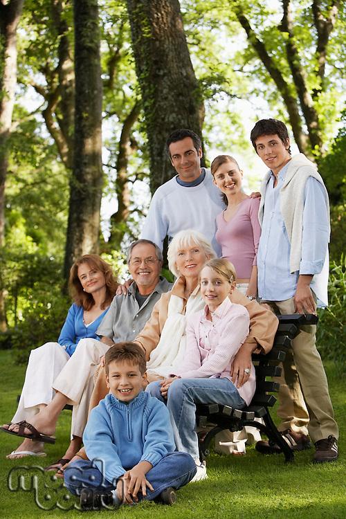 Family posing for portrait in back yard portrait