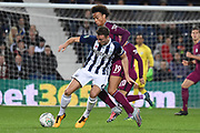 Manchester City midfielder Leroy Sane (19) battles for possession with West Bromwich Albion defender Jonny Evans (6) 0-1 during the EFL Cup match between West Bromwich Albion and Manchester City at The Hawthorns, West Bromwich, England on 20 September 2017. Photo by Alan Franklin.