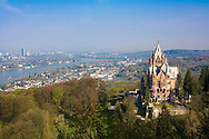 Europe, Germany, North Rhine-Westphalia, Siebengebirge, Koenigswinter, the Drachenburg castle (built 1881-84) at the Drachenfels, view to the city of Bonn in the background.<br /> <br /> Europa, Deutschland, Nordrhein-Westfalen, Siebengebirge, Koenigswinter, die Drachenburg (1881-84) am Hang des Drachenfels, im Hintergrund ist Bonn zu sehen.