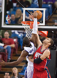November 27, 2009; Sacramento, CA, USA;  Sacramento Kings forward Jason Thompson (34) is fouled by New Jersey Nets center Brook Lopez (11) during the first quarter at the ARCO Arena. Sacramento defeated New Jersey 109-96.