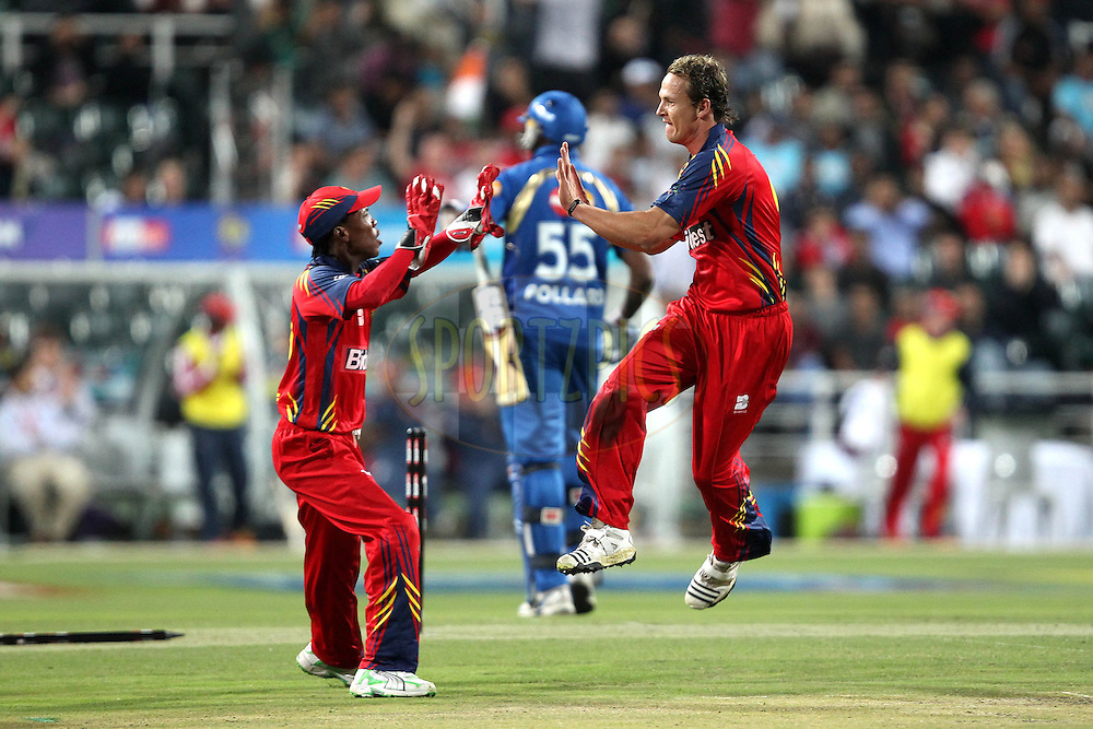 Shane Burger and Thami Tsolekile celebrate the wicket of Kieron Pollard during the Airtel CLT20 opening ceremony and 1st match held between the Mumbai Indians and The Highveld Lions at The Wanderers Stadium in Johannesburg on the 10 September 2010..Photo by: Ron Gaunt/SPORTZPICS/CLT20