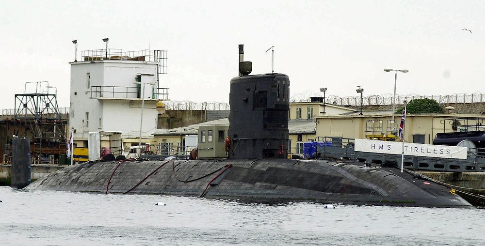 Royal Navy submarine HMS Tireless tied alongside the dockyard in Gibraltar for repairs