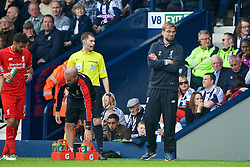 WEST BROMWICH, ENGLAND - Sunday, May 15, 2016: Liverpool's manager Jürgen Klopp argues with the assistant referee during the final Premier League match of the season against West Bromwich Albion at the Hawthorns. (Pic by David Rawcliffe/Propaganda)