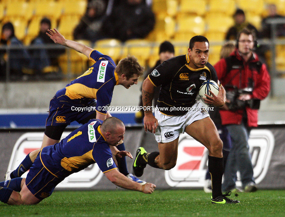 Hosea Gear leaves Otago's Chris Noakes and Ben Nolan in his wake.<br /> Air NZ Cup Ranfurly Shield match - Wellington Lions v Otago at Westpac Stadium, Wellington, New Zealand. Friday, 31 July 2009. Photo: Dave Lintott/PHOTOSPORT