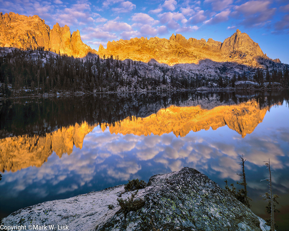 Cotton like clouds hang over the blue water of Upper Baron Lake in the Sawtooth Wilderness area, Idaho.