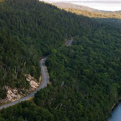 The Park Loop Road snakes between Jordan Pond and Pemetic Mountain in Maine's Acadia National Park.