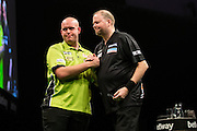 Michael van Gerwen & Raymond van Barneveld draw their match 6-6  during the Premier League Darts  at the Motorpoint Arena, Cardiff, Wales on 31 March 2016. Photo by Shane Healey.