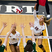 18 November 2017:  The San Diego State women's volleyball team closes out it's season against #24 Colorado State University. San Diego State outside hitter Alexis Cage (18) spikes the ball past two CSU defenders in the first set. The Aztecs fell to the Rams in three sets. <br /> www.sdsuaztecphotos.com