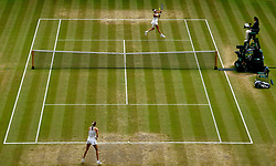 Garbine Muguruza (top) in action against Magdalena Rybarikova on day ten of the Wimbledon Championships at The All England Lawn Tennis and Croquet Club, Wimbledon.