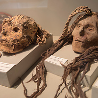 Two mummified heads from the Nazca period on display at the Museo Didactico Antonini in Nazca, Peru.