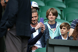 © London News Pictures. David Beckham and his son Cruz sit down to watch Andrew Murray (GB) play Vasek Pospisil (CAN) in the men's Wimbledon Tennis Championships today. 07.07.2015. Photo credit: LNP