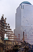 """22 SEPTEMBER 2011 - NEW YORK, NY: Smoke still rises from the rubble of the wreckage of the World Trade Center complex at """"Ground Zero"""" of the WTC terrorist attack, Sept. 22, 2001, eleven days after the attack.  More than 2,900 people were killed when terrorists crashed two airliners into the towers on Sept. 11, 2001.  PHOTO BY JACK KURTZ"""