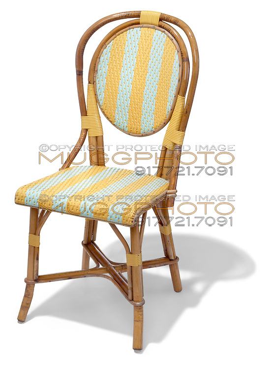 rattan chair in blue and yellow and wood
