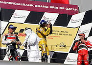 From left to right, American Nicky Hayden finishes in second place, Italy's Valentino Rossi kisses his trophy in his 1st place finish, and Spain's Sete Gibernau celebrates his 3rd place finish in the Commercial Bank Grand Prix of Qatar, MOTO GP class, Losail International Circuit, 8 April 2006