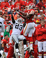 Wide receiver Dwayne Bowe (82) of the Kansas City Chiefs catches a 32-yard pass over defensive back DeAngelo Hall (23) of the Oakland Raiders in the fourth quarter at Arrowhead Stadium in Kansas City, Missouri on September 14, 2008....