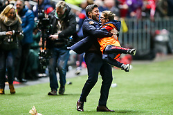 Bristol City Head Coach Lee Johnson celebrates with a ball boy after Korey Smith scores a goal in the 93rd minute to make it 2-1 and win the match for his side - Rogan/JMP - 20/12/2017 - Ashton Gate Stadium - Bristol, England - Bristol City v Manchester United - Carabao Cup Quarter Final.