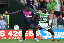Aston Villa's Axel Tuanzebe and Yeovil Town's Diallang Jaiyesimi during the Carabao Cup, First Round match at Huish Park, Yeovil.