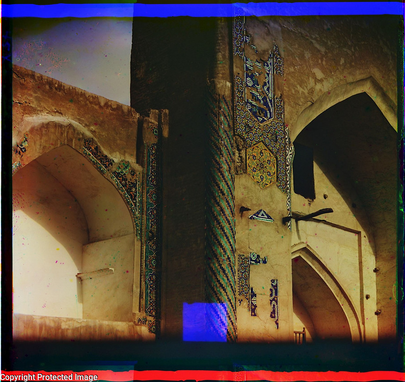 1905<br /> The Astrakhanid dynasty in Bukhara during the 17th century was adept at organizing urban space.  The Liabi-Khauz complex is a fine example. It was a trading area with a square reservoir that provided water and served as a reflecting pool for three adjacent religious buildings. Among them is the madrasah (religious school) built in 1622&ndash;23 by Nadir Divan-begi, a vizier (high official) and uncle of the Bukhara ruler Iman Kuli-Khan. This photograph shows a fragment of the left side of the main facade, which contains the great peshtak (entrance arch). The adobe brick walls were originally covered with polychrome ceramic tiles (severely damaged) in a variety of geometric, floral, and inscriptional patterns. The image is by Russian photographer Sergei Mikhailovich Prokudin-Gorskii (1863&ndash;1944), who used a special color photography process to create a visual record of the Russian Empire in the early 20th century. Some of Prokudin-Gorskii&rsquo;s photographs date from about 1905, but the bulk of his work is from between 1909 and 1915, when, with the support of Tsar Nicholas II and the Ministry of Transportation, he undertook extended trips through many different parts of the empire. In 1911 his travels took him to an area of Central Asia then known as Turkestan (present-day Uzbekistan and neighboring states), where he photographed many of the ancient monuments of Bukhara.