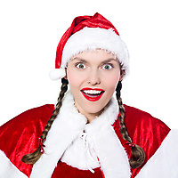 one woman christmas surprised joyful dressed as santa claus on studio isolated white background
