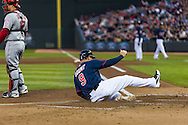 Ryan Doumit #9 of the Minnesota Twins slides safely into home during a game against the Los Angeles Angels on April 16, 2013 at Target Field in Minneapolis, Minnesota.  The Twins defeated the Angels 8 to 6.  Photo: Ben Krause